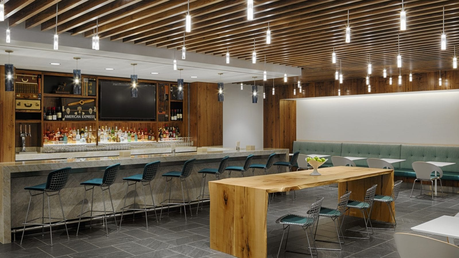 A bar and dining area at the AMEX Centurion Lounge