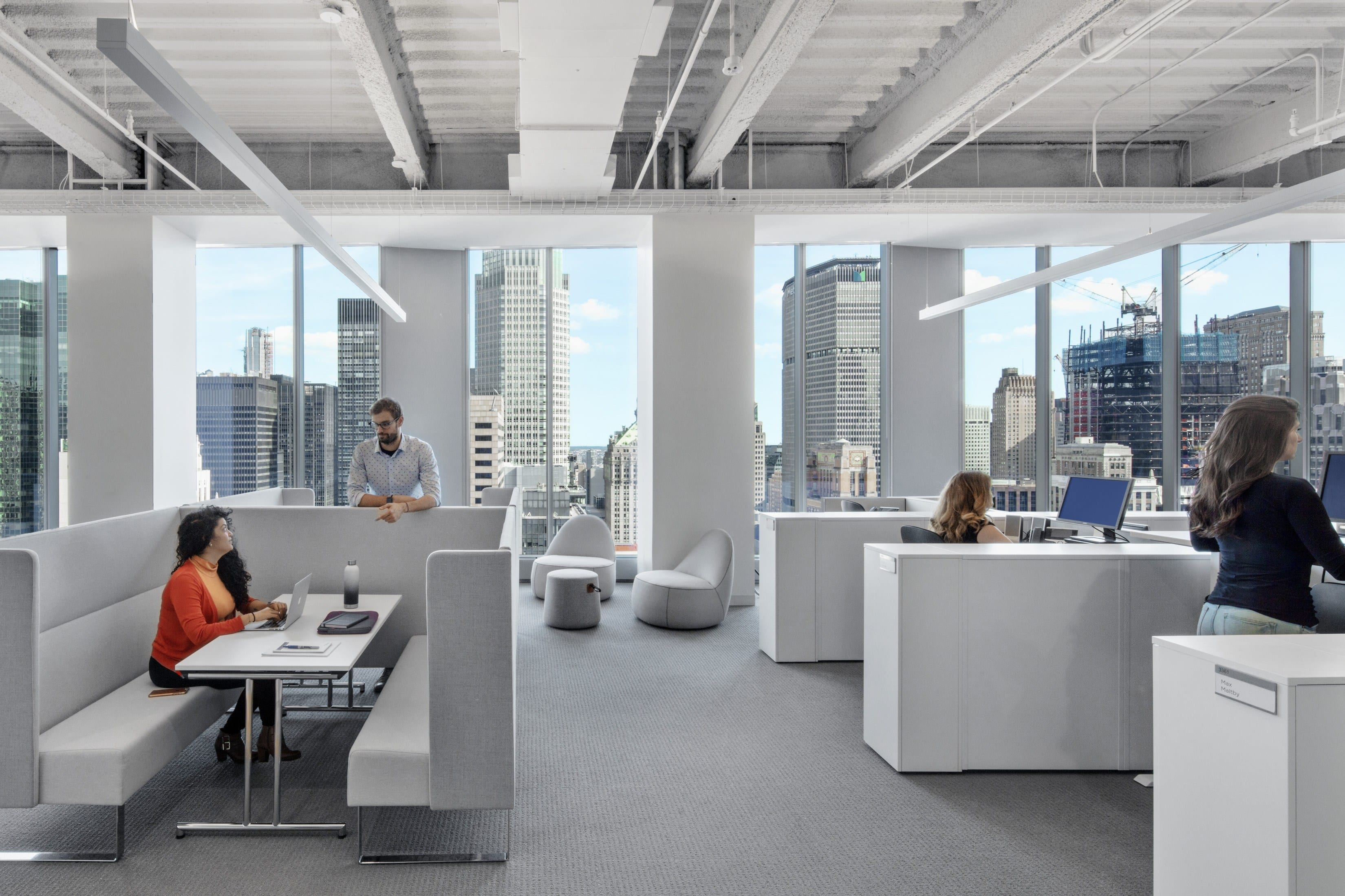 The group work space features full-length windows