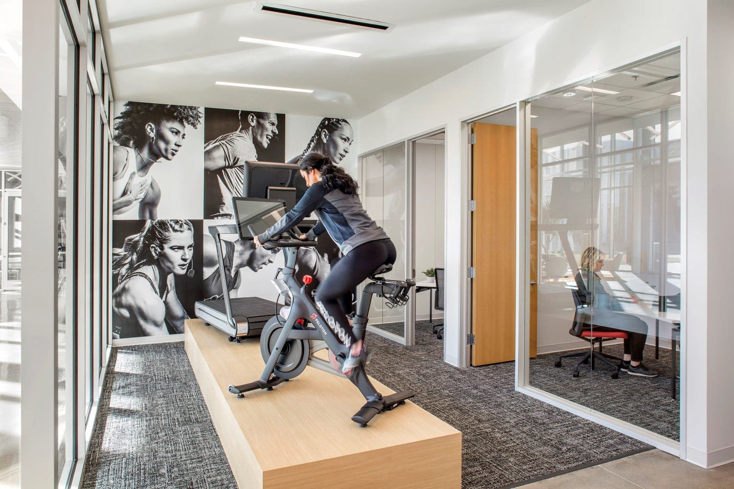 Large-scale wall graphics at the Peloton Customer Care Center.